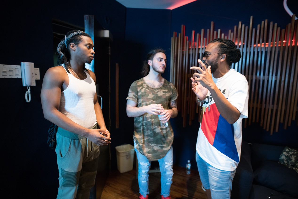Machel giving sound advice to Tyler Auguste and Jean Farrah, duo from St. Lucia who won in the Performer category at the Digicel Music Academy.