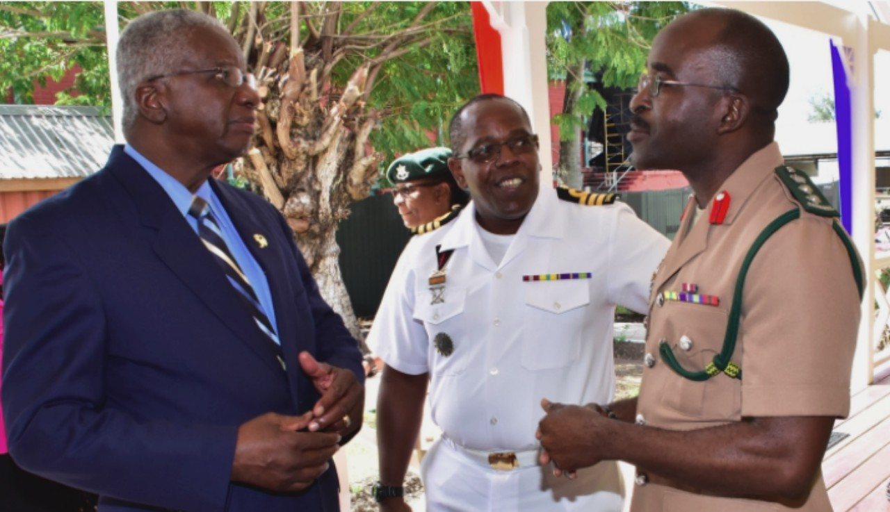 Prime Minister Freundel Stuart chatting with BDF Chief of Staff, Colonel Glyne Grannum (right) and Deputy Chief of Staff, Commander Aquinas Clarke at the launch of the Barbados Defence Force's website today at St. Ann's Fort. (C.Pitt/BGIS)