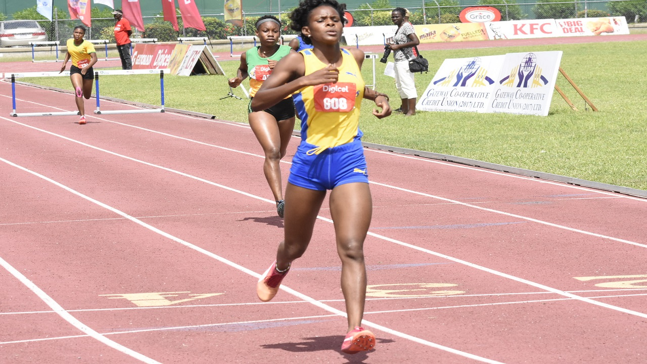 STETHS' Winsome Harris wins the Girls' 400-metre open hurdles final on Saturday at Western Championships at the Montego Bay Sports Complex. Harris won in a meet record time of 1:01.67 seconds. (PHOTO: Marlon Reid).