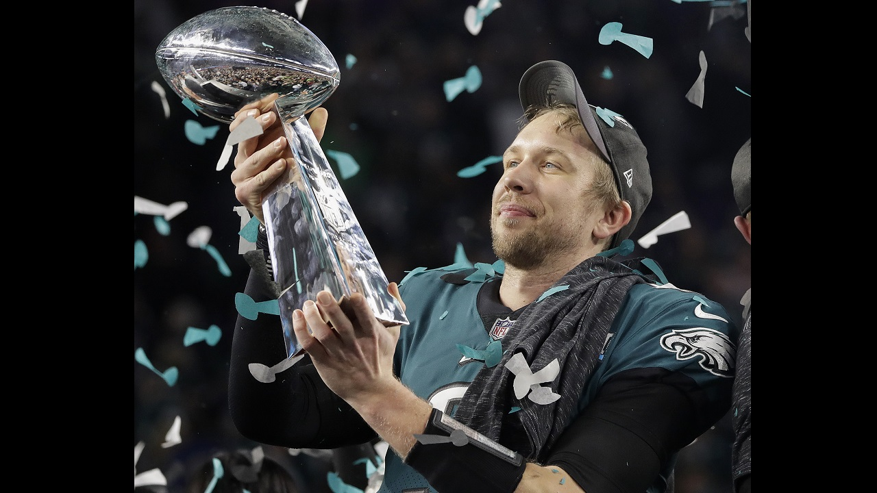 Philadelphia Eagles' Nick Foles holds up the Vince Lombardi Trophy after the NFL Super Bowl 52 football game against the New England Patriots, Sunday, Feb. 4, 2018, in Minneapolis. The Eagles won 41-33. (AP Photo/Matt Slocum)