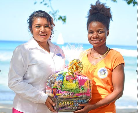 (L-R) WIBISCO's Abigail Brown, making an on location presentation to Carla Daniel of Director of Public Awareness and Education with the Barbados Sea Turtle Project.