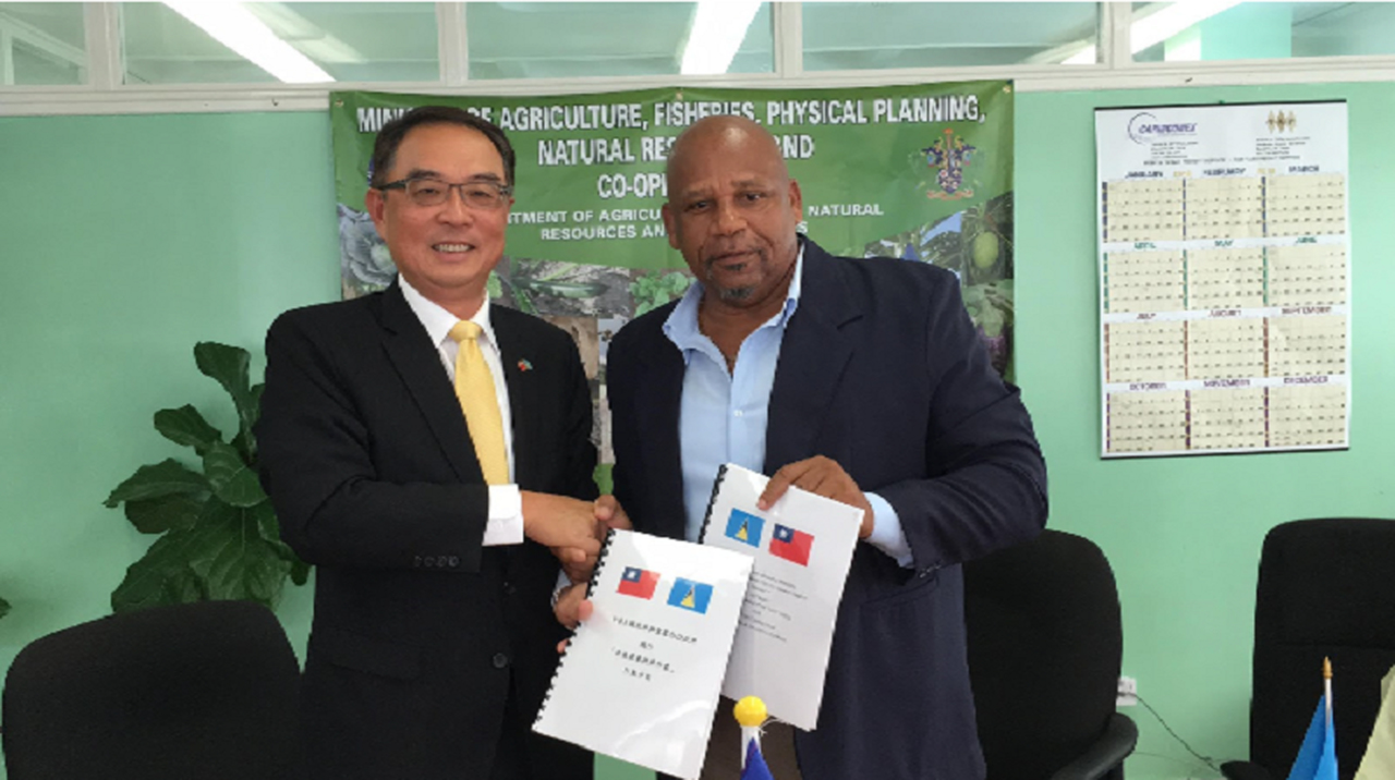 "Taiwanese ambassador H. E. Douglas Shen and Hon. Ezechiel Joseph, Minister for Agriculture, Fisheries, Physical Planning, Natural Resources and Co-operatives, representing the governments from two sides co-signed ""Banana Productivity Improvement Project"" Action plan"