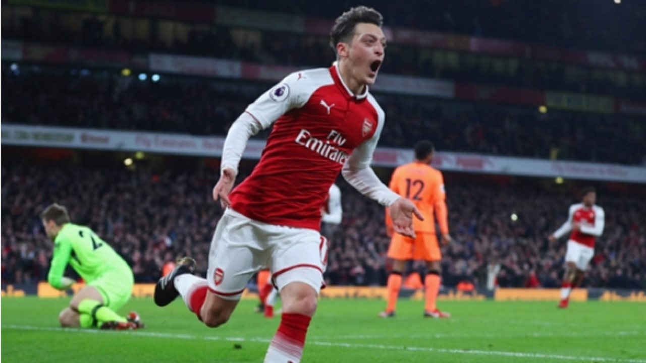 Mesut Ozil celebrates an Arsenal goal.