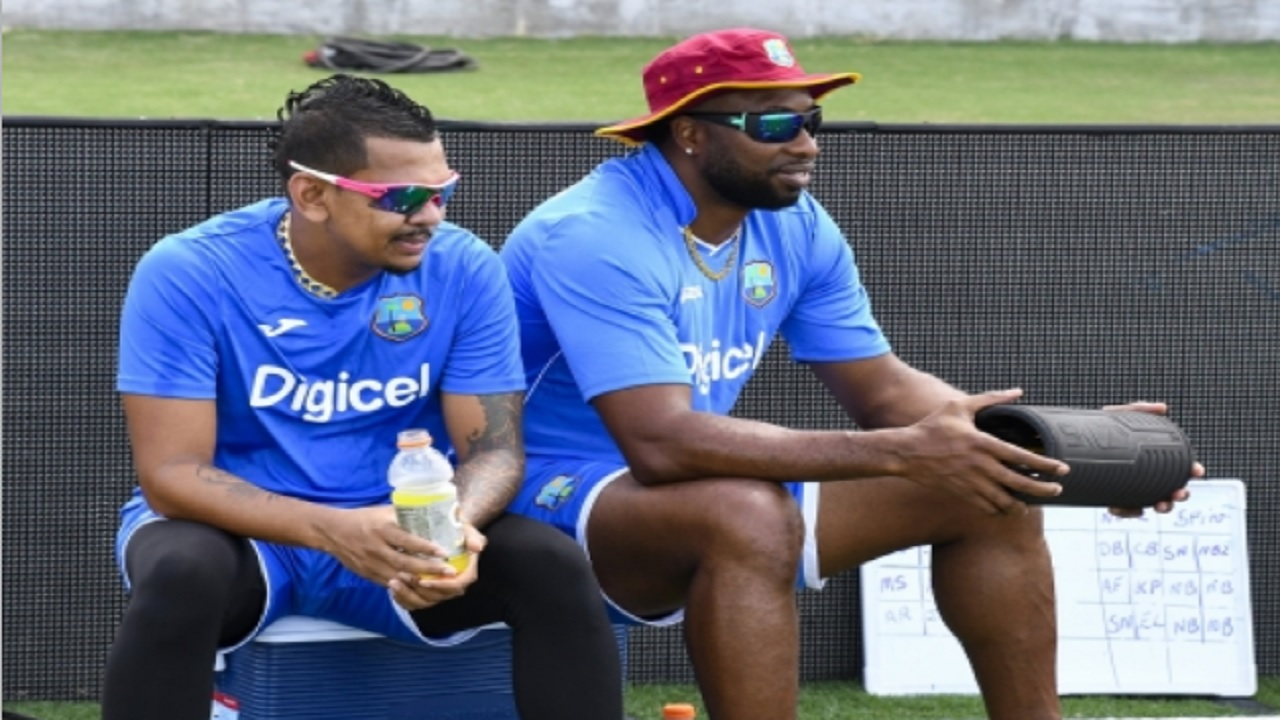 Sunil Narine (left) and Kieron Pollard.
