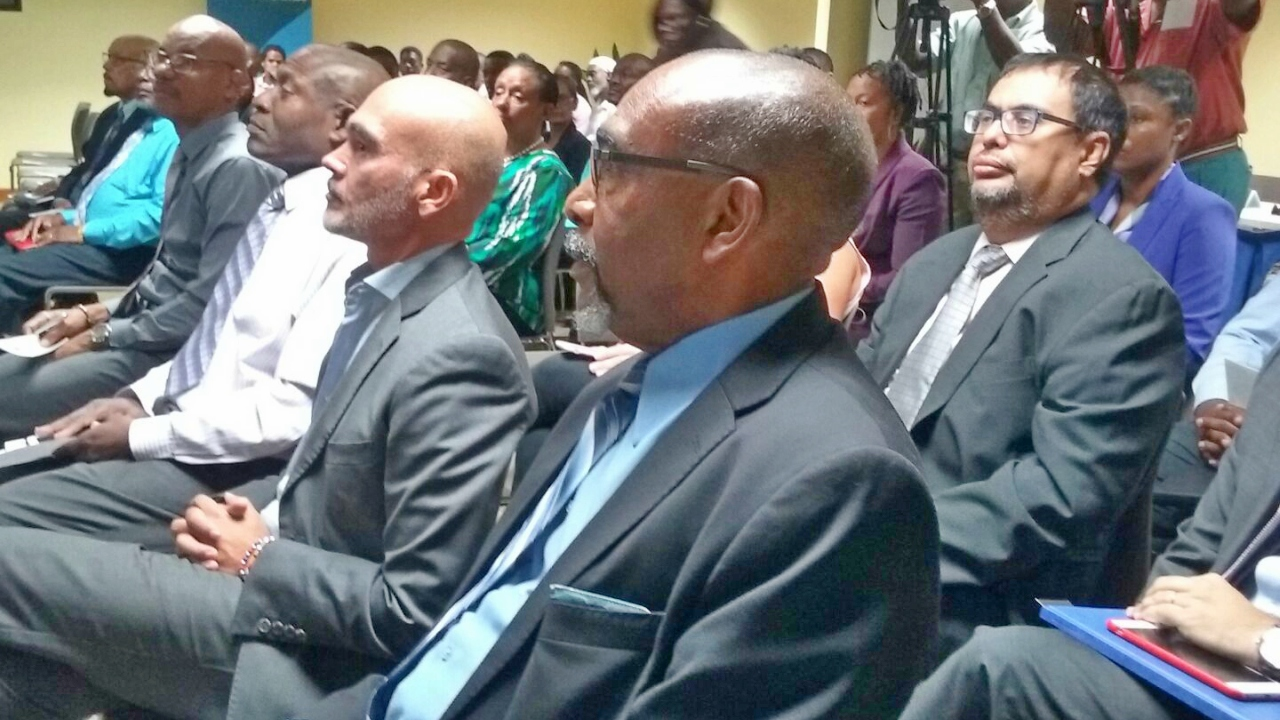 Minister with responsibility for Energy,  Senator Darcy Boyce (closest to screen); Barbados Country Representative of the Inter-American Development Bank (IDB), Juan Carlos De La Hoz Viñas, (to his right).