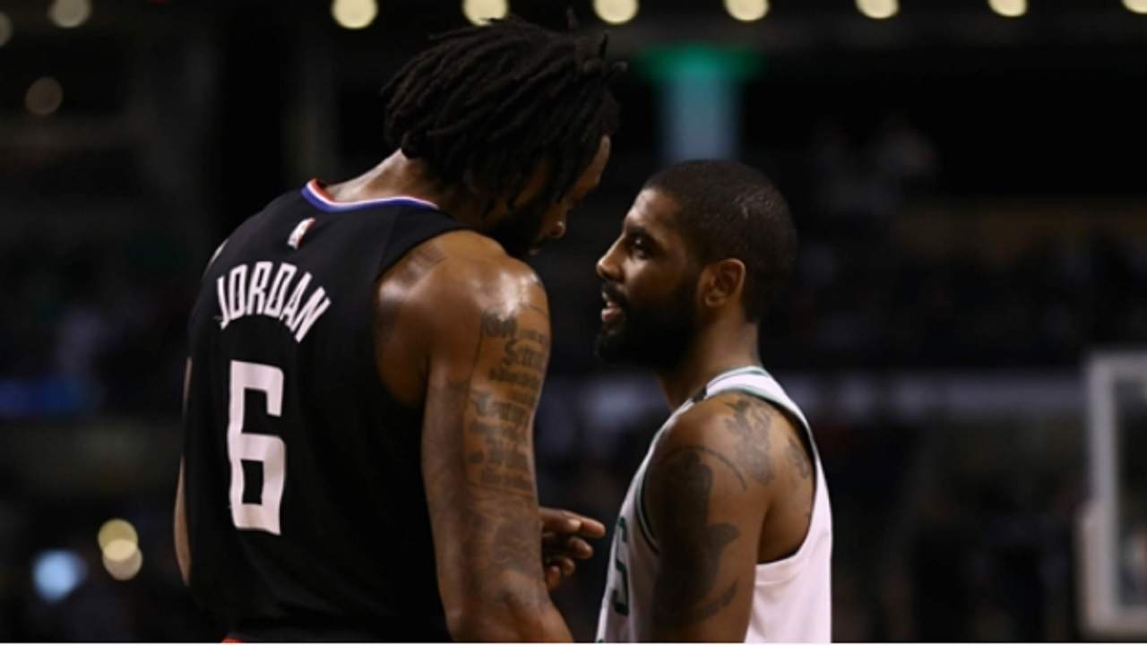 DeAndre Jordan and Kyrie Irving.
