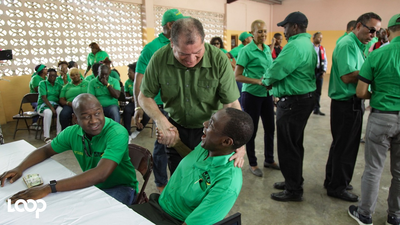 Dr Nigel Clarke (right), the JLP candidate for North West St Andrew, is greeted by Finance Minister Audley Shaw (centre) while Duane Smith, councillor for the Chancery Hall Division and son of former MP Derrick Smith, looks on during Nomination Day activities. (PHOTOS: Shawn Barnes)