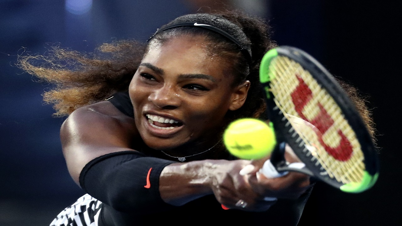 Serena Williams makes a backhand return to her sister Venus during the women's singles final at the Australian Open tennis championships in Melbourne Australia