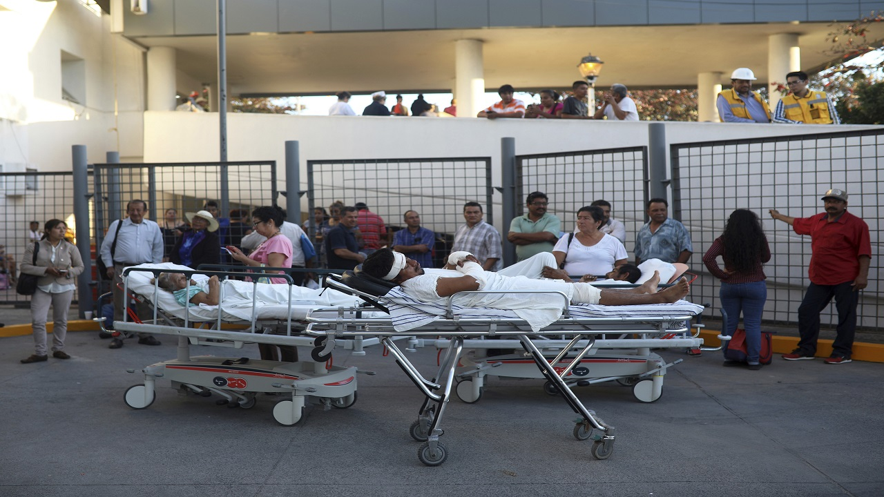Patients rest in their hospital beds parked outside the General Hospital after they were evacuated, in Veracruz, Mexico, Friday, Feb. 16, 2018. A powerful magnitude-7.2 earthquake shook south and central Mexico Friday, causing people to flee swaying buildings and office towers in the country's capital, where residents were still jittery after a deadly quake five months ago.