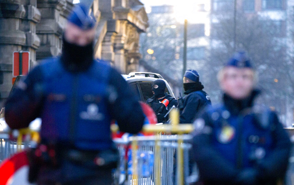 A police convoy carrying Salah Abdeslam and other members of the trial arrives under police guard at the Brussels Justice Palace. (AP Photo/Virginia Mayo)