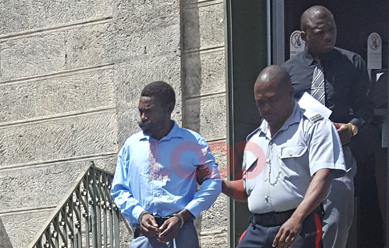 Sean Inniss in police custody.