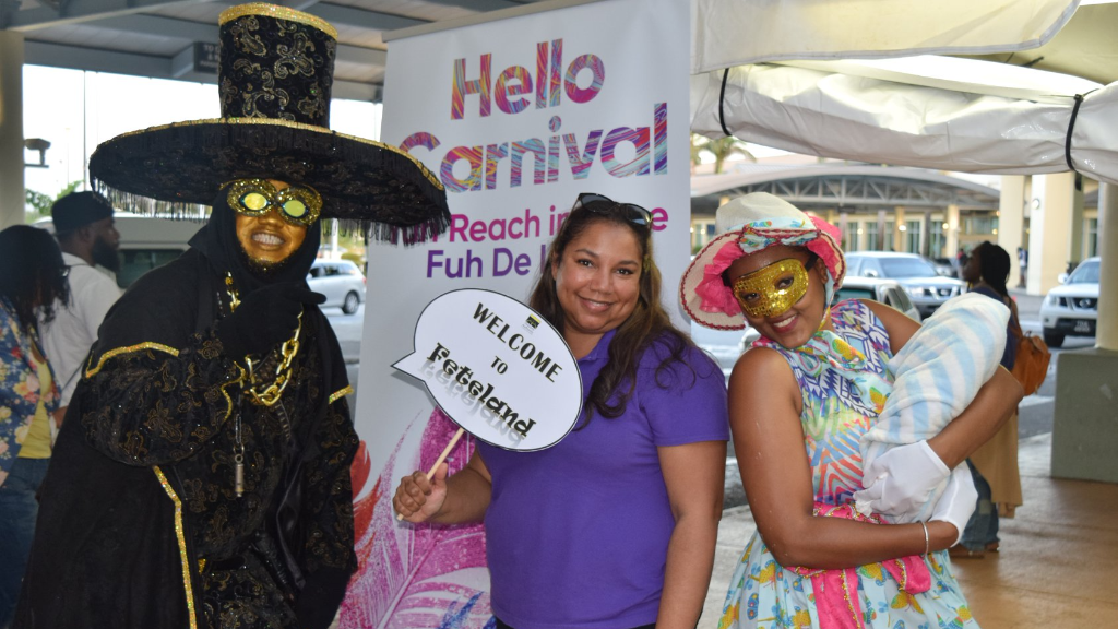 Carnival arrivals are treated to a display of traditional Carnival characters at the Piarco International Airport on Thursday. Photo via Facebook, The Airports Authority of Trinidad and Tobago.