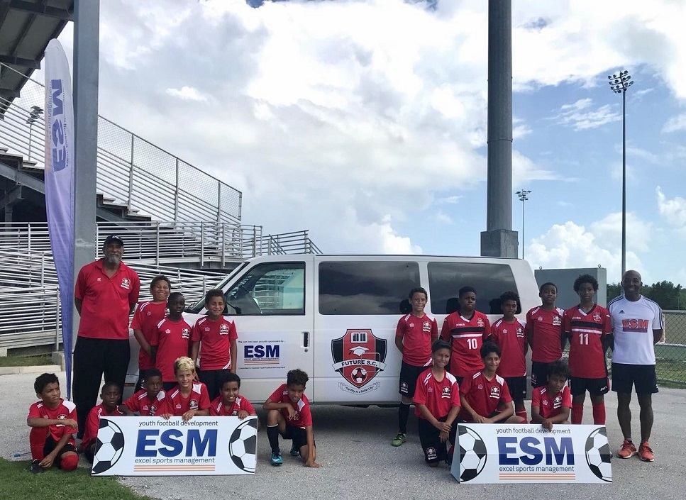 excel sports management supports youth football in cayman