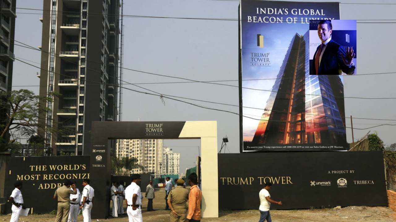 Policemen stand guard in front of the construction site of Trump Tower in Kolkata, India. (AP Photo/Bikas Das) [Insert, top-right] Donald Trump Jr waves to media as he arrives for a meeting in Kolkata, India. (AP Photo/Bikas Das)