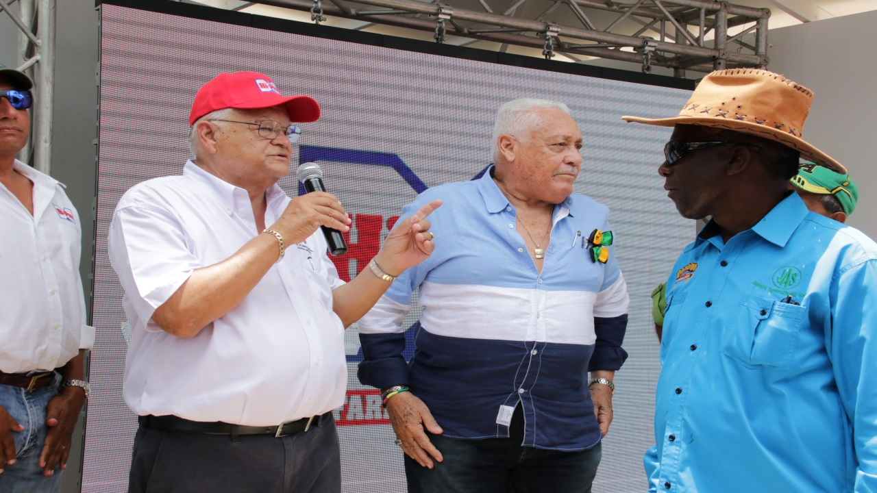 File photo of Agriculture Minister Karl Samuda (left) addressing last year's Denbigh Agricultural Show. Also pictured are JAS president Norman Grant (right) and Transport Minister Mike Henry.