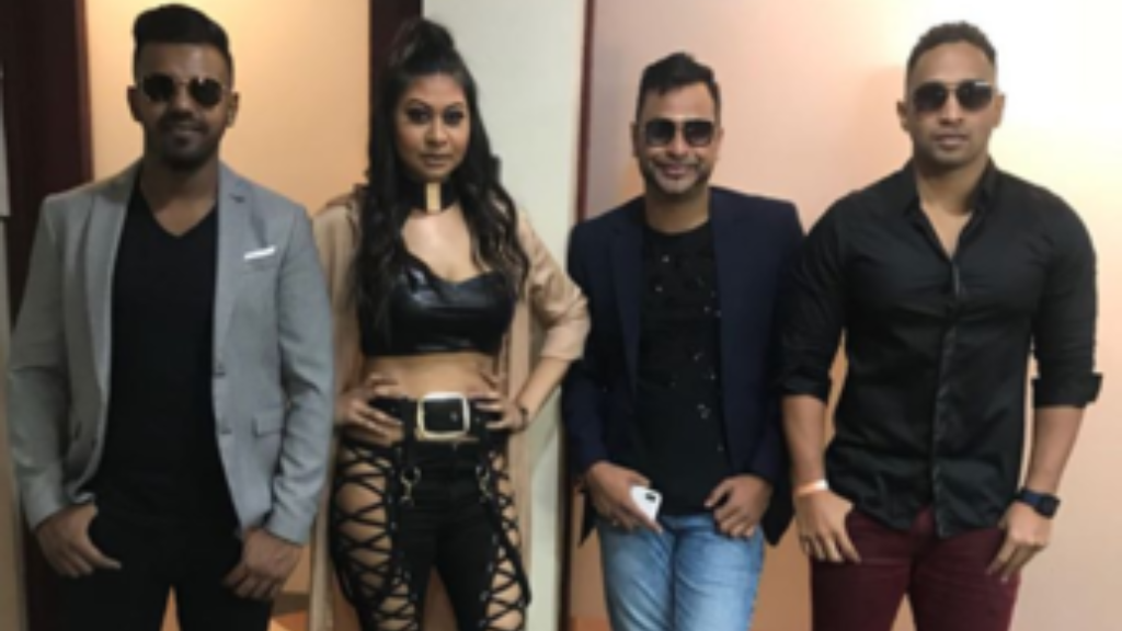 Nisha B, second from left, poses with chutney group Karma.