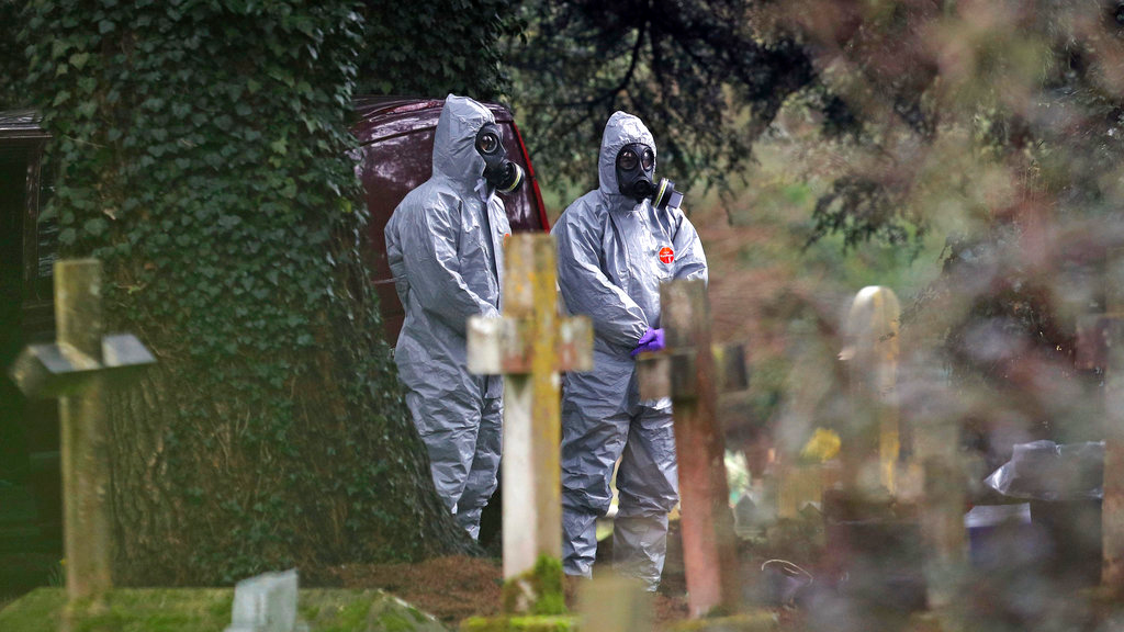 Forensic officers work at the cemetery in Salisbury, England. (PA via AP)