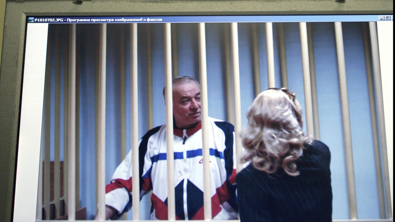 (Image: AP: In an image from 9 August 2006, Sergei Skripal is seen on a monitor outside a courtroom in Moscow)