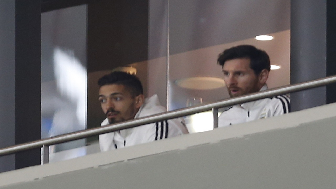 Lionel Messi, right, watches the international friendly football match between Spain and Argentina at the Wanda Metropolitano stadium in Madrid, Spain, Tuesday, March 27, 2018.