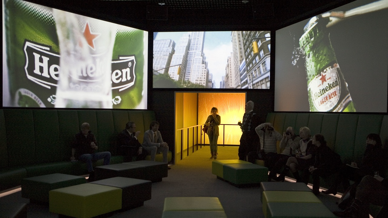 (Image: AP: File image of Heineken commercials on screen at the Heineken Experience in 2008)