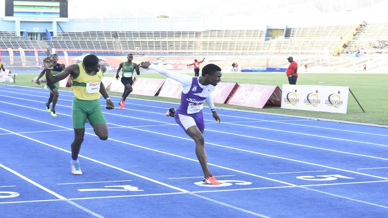 Kingston College's Santhamol Brown holds off Devonte Archer of Excelsior High in the Boys' Under 17 400-metre hurdles final at the Digicel Grand Prix Finale - G C Foster Classic - at the National Stadium on Saturday. (PHOTO: Marlon Reid).