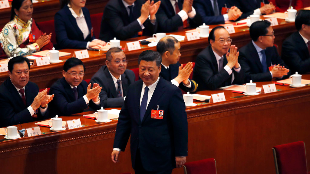 Delegates applaud as Chinese President Xi Jinping walks to his seat after casting his vote for an amendment to China's constitution that will abolish term limits on the presidency and enable him to rule indefinitely, during a plenary session of the National People's Congress at the Great Hall of the People in Beijing, Sunday, March 11, 2018. (AP Photo/Andy Wong)