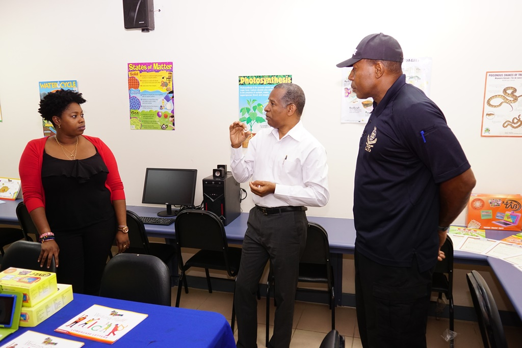 Cindyann Currency, Digicel Foundation Operations Manager, listens attentively to Sterling Belgrove, Development, Director at the Hearts and Mind Foundation (centre) as Sergeant Jones, Finance Director of the Hearts and Minds Foundation looks on