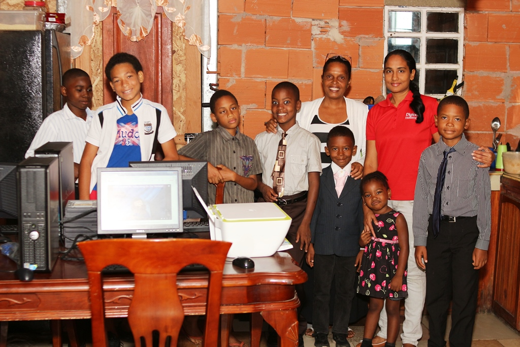 The children pose with their guardian and co-founder of Charity Promotions, Kathleen Hypolite and Project Coordinator at the Digicel Foundation, Diana Mathura-Hobson (second from right)