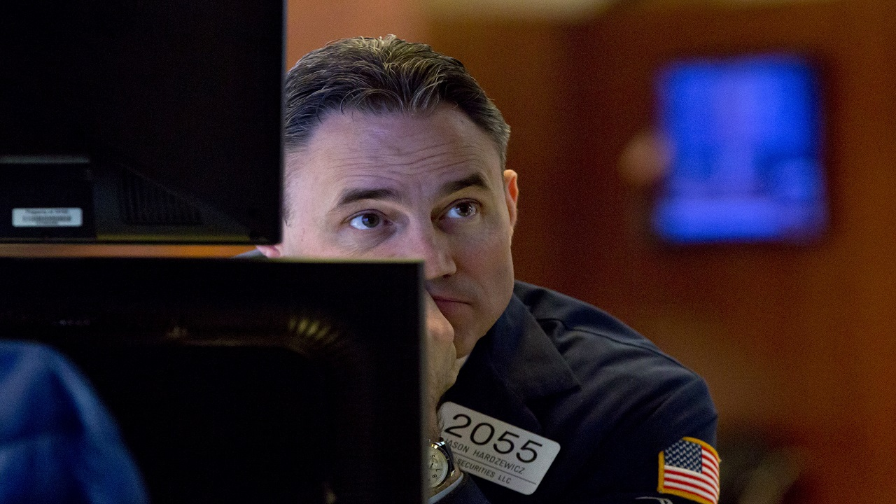 Specialist Jason Hardzewicz works on the floor of the New York Stock Exchange, Thursday.