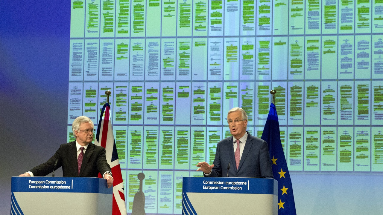 (Image: AP: EU chief Brexit negotiator Michel Barnier (R) and British Brexit minister David Davis address reporters on 19 March 2018)