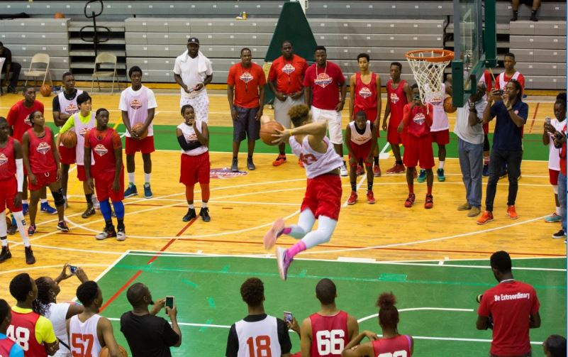 #ShowUsWhyYouPlay - A participant from last year's Digicel NBA Jumpstart programme puts his all into the net.
