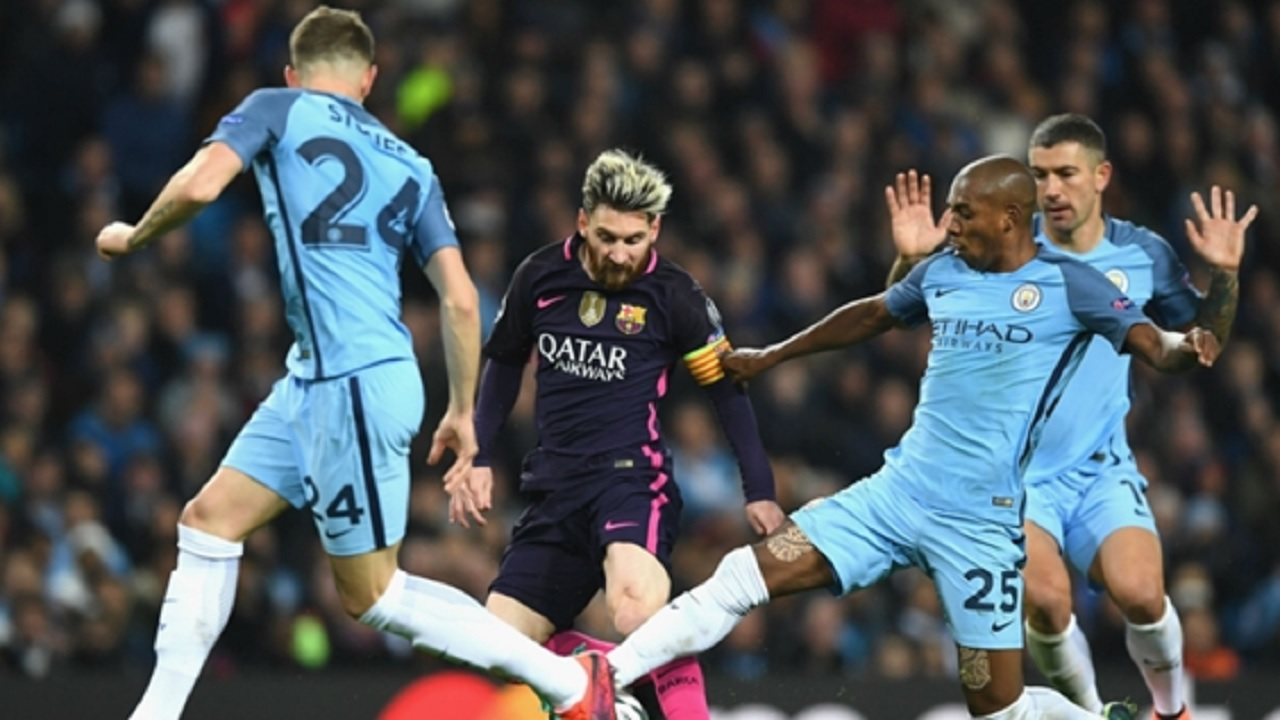 Lionel Messi takes on Manchester City.
