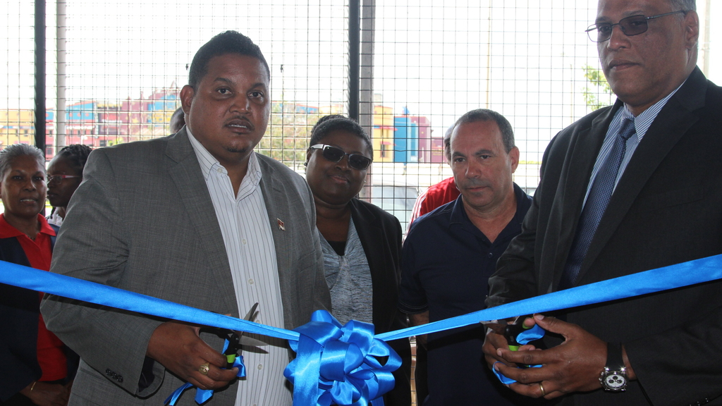 The Honourable Darryl Smith, Minister of Sport and Youth Affairs and Dr. Barry Ishmael, Chairman of the Trinidad Boxing Board of Control (TBBC) cut the ribbon to officially open the new office location of the TBBC, at the Hasely Crawford Stadium on Friday, March 16.