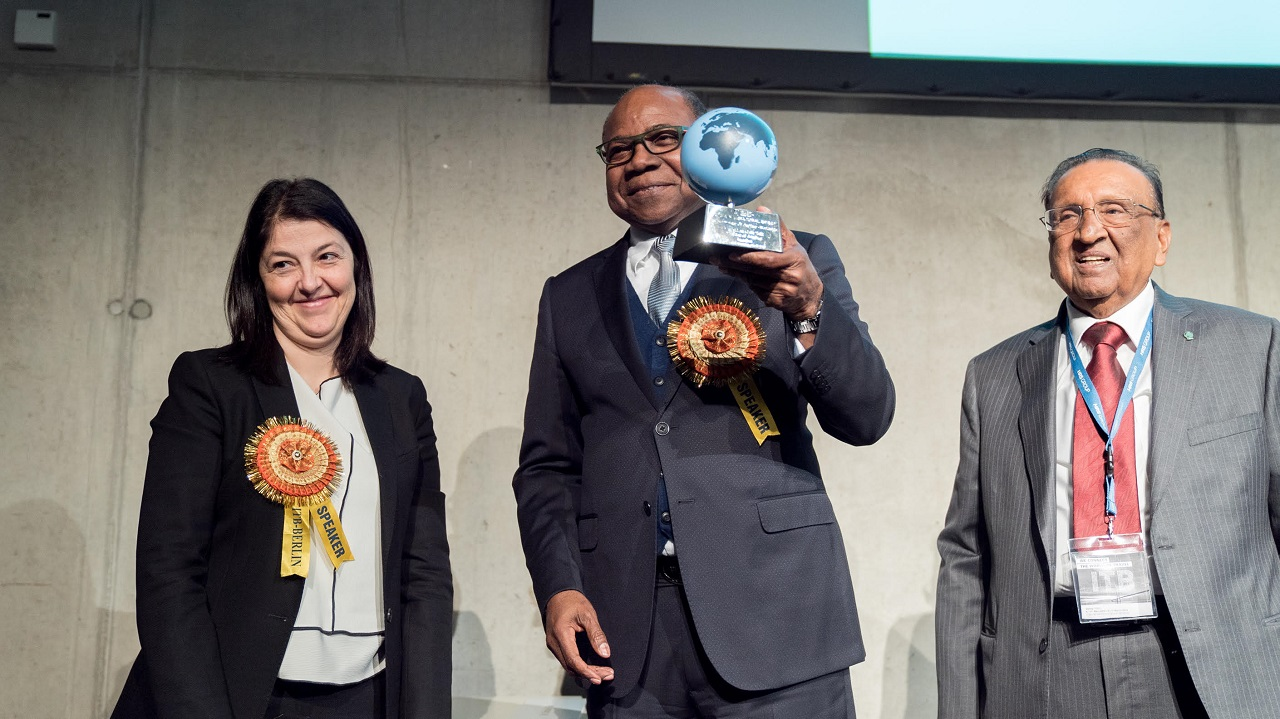 Tourism Minister, Edmund Bartlett (centre) holds his Worldwide Tourism Minister of the Year Award by the  Pacific Area Travel Writers Association (PATWA) following its presentation at the ITB Global Tourism Tradeshow in Berlin, Germany. To his left is Sandra Carvao, Chief of Communications for the United Nations World Tourism Organisation (UNWTO) and to his right, Secretary General of PATWA, Sagar Ahluwalia.