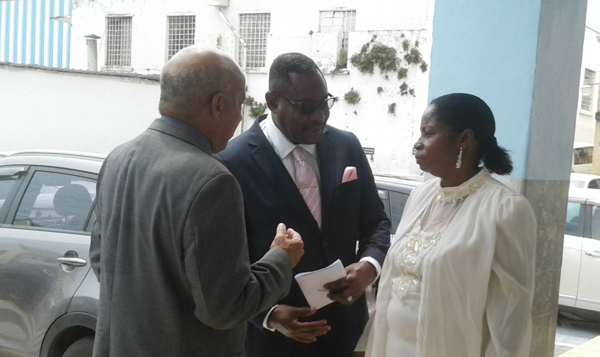 Minister of Social Care and Constituency Empowerment, Steven Blackett (center) in conversation with members of the Calvary Movarian Church.