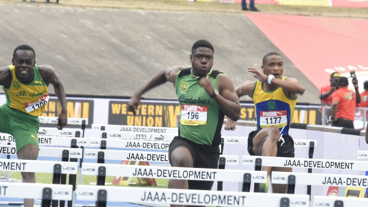 Dejour Russell of Calabar High powers home to win the Boys' Class 1 110-metre hurdles final on Saturday at the ISSA/GraceKennedy Boys and Girls' Athletics Championships. (PHOTO: Marlon Reid).