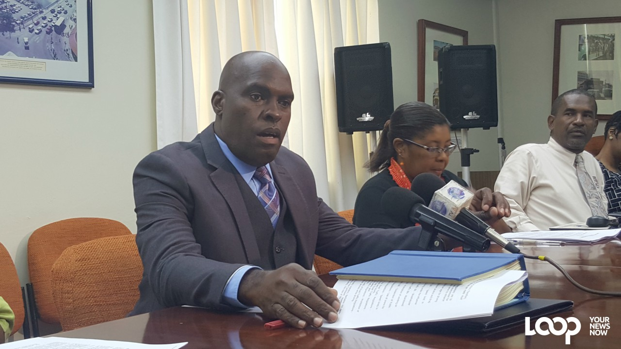 Minister of Transport and Works, Michael Lashley at the press conference at the Ministry's headquarters.