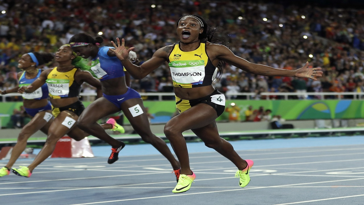 In this Aug. 13, 2016, file photo, Jamaica's Elaine Thompson reacts after winning gold in the women's 100m final during the athletics competitions in the Olympic stadium of the 2016 Summer Olympics in Rio de Janeiro, Brazil.