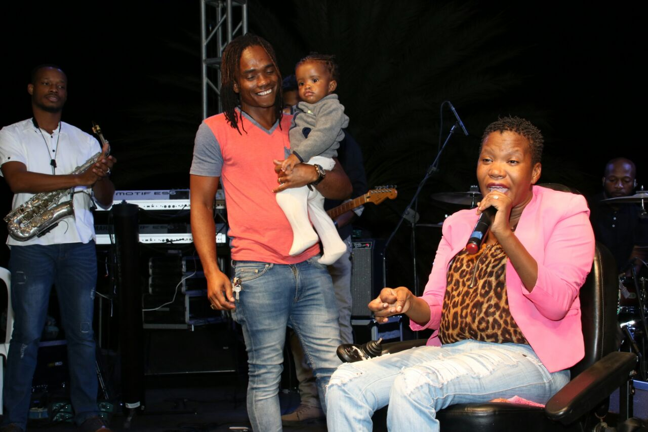 David Reid, with their son in arm, proudly looked on as his wife, Davianna, held centre-stage at a recent gospel concert in downtown Kingston.