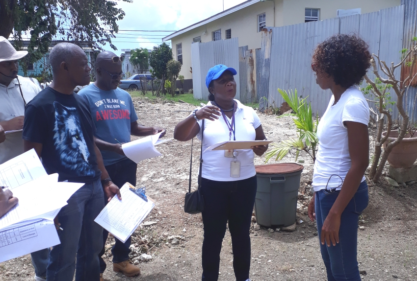 "Damage Assessment Training Officer at the BSS, Valerie Taylor (second right), interviews Silvia Griffith (right) about the ""damage"" to her home.