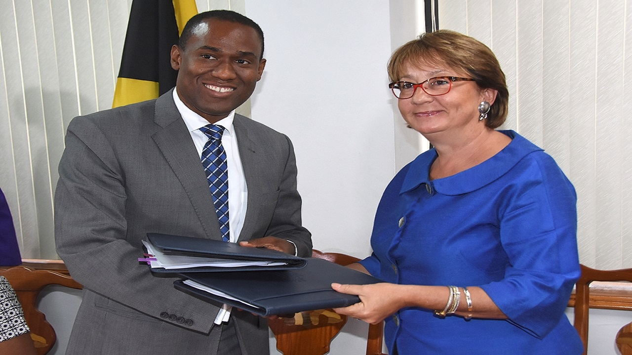 Minister of Finance Dr Nigel Clarke (left) and World Bank Country Manager Galina Sotirova.