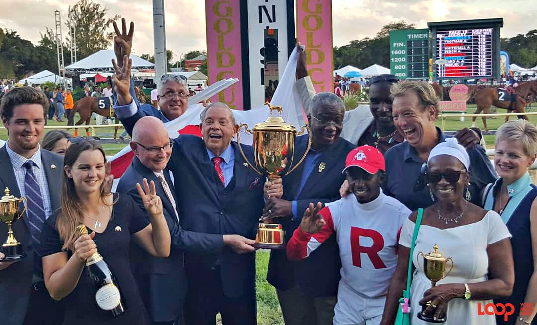 Jalon Samuel and the owners, and trainers of Sir Dudley Digges along with the Prime Minister of Barbados, the Rt. Hon. Freundel Stuart during the Gold Cup presentation.