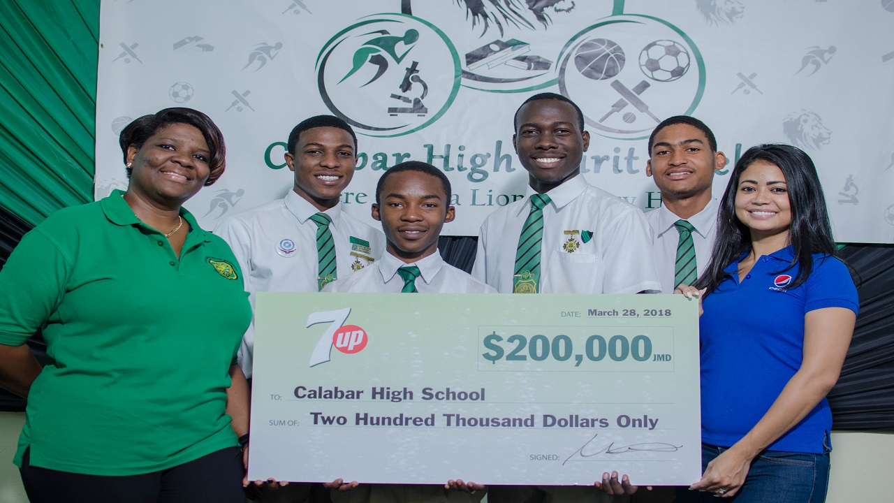 Elizabeth Allen (right), Brand Manager, Carbonated Beverages, Pepsi-Cola Jamaica presents a cheque for $200,000 to Calabar High School's Vice-Principal, Sian Wilson and students (L-R) Kimani Danvers, Student Council President; Jhevonte Webster, Head Boy; Keano Clarke Deputy Head Boy; and Akeem Davis, Deputy Head Boy.