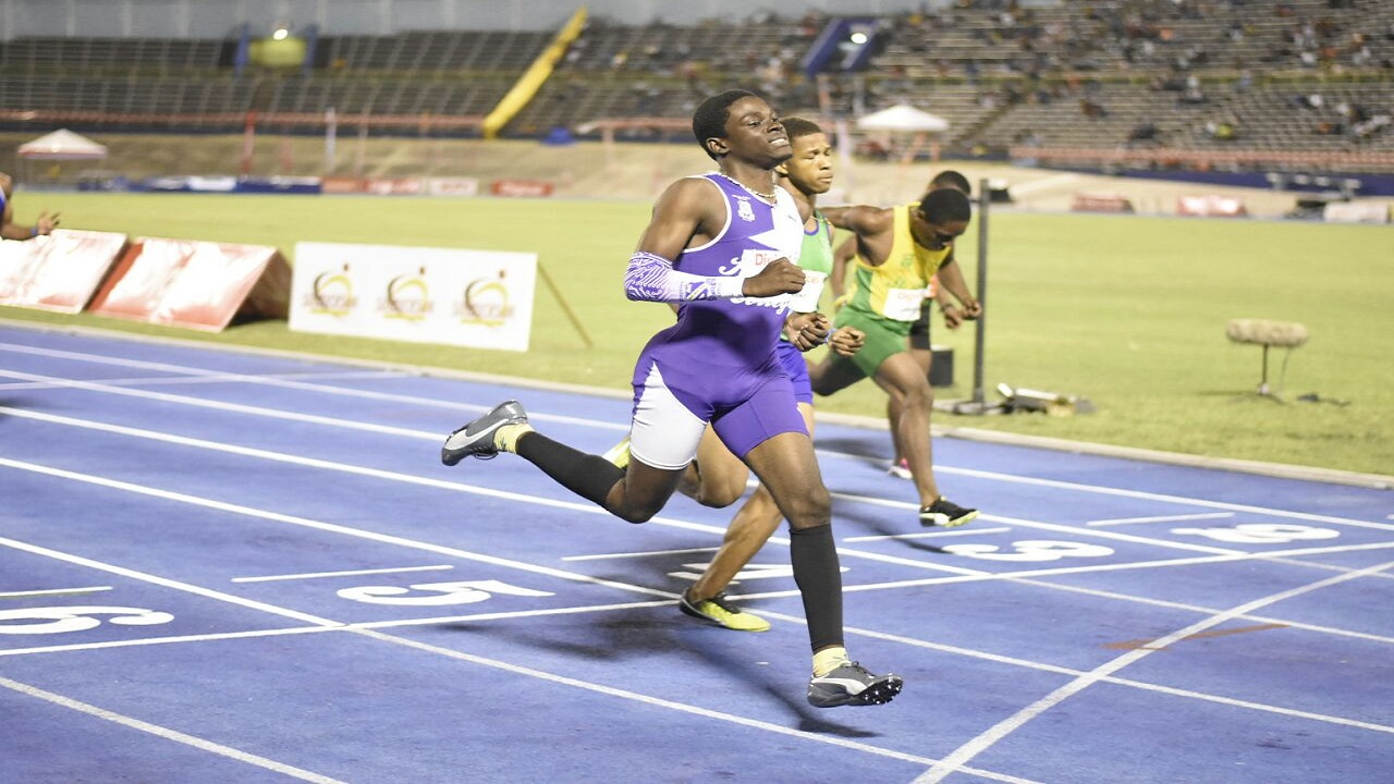 Kingston Colleges' Terrique Stennett (left) win the Boys' Under 17 100-metre final at the Digicel Grand Prix Finale on Saturday at the National Stadium. (PHOTO: Marlon Reid).