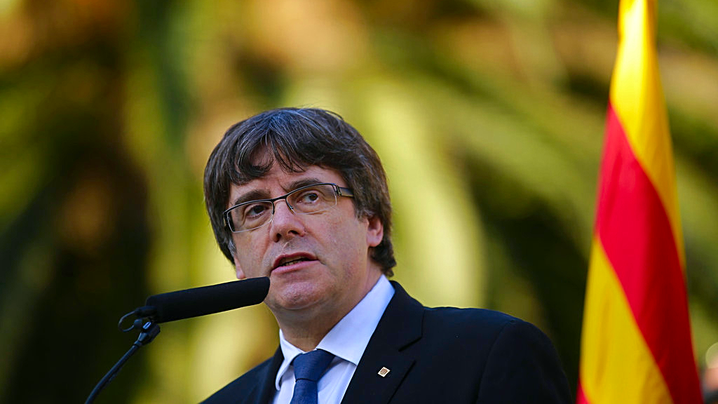 Catalan regional President Carles Puigdemont addresses to the media after a ceremony commemorating the 77th anniversary of the death of Catalan leader Lluis Companys at the Montjuic Cemetery in Barcelona, Spain, Sunday, Oct. 15, 2017. (AP Photo/Manu Fernandez)