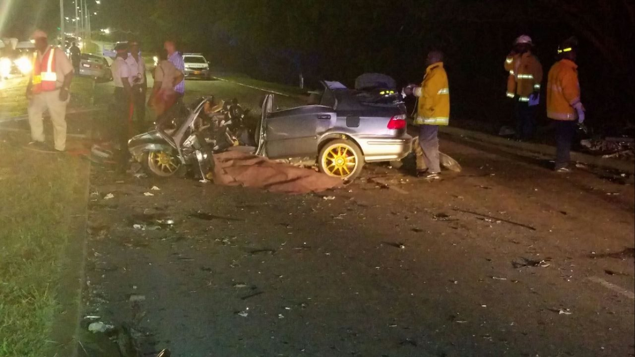 The mangled remains of one of the four cars that were involved in a fatal collision on the Ironshore main road in St James on Thursday.
