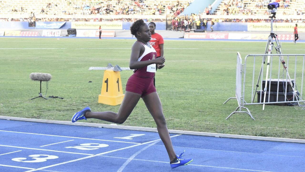 Holmwood Technical's Rickiann Russell wins the Girls' Under 17 400 metres final in a new meet record of 54.41 seconds at the Digicel Grand Prix Finale at the National Stadium on Saturday. (PHOTO: Marlon Reid).