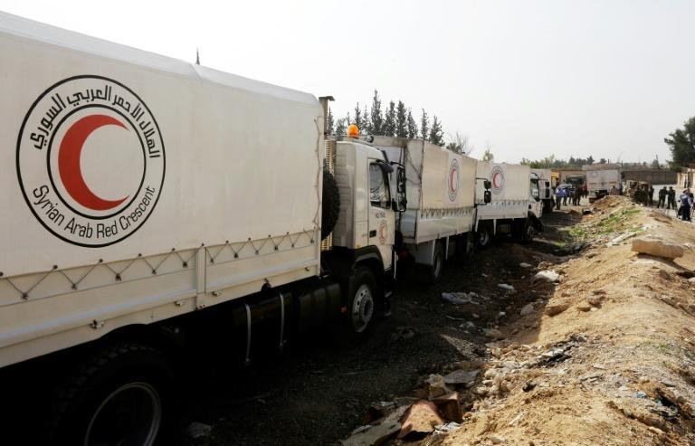 Ghouta orientale en périphérie de Damas, des véhicules de convois d'aide assiégée au point de passage d'al-Wafidin  le 5 mars 2018  Louai Beshara (AFP)
