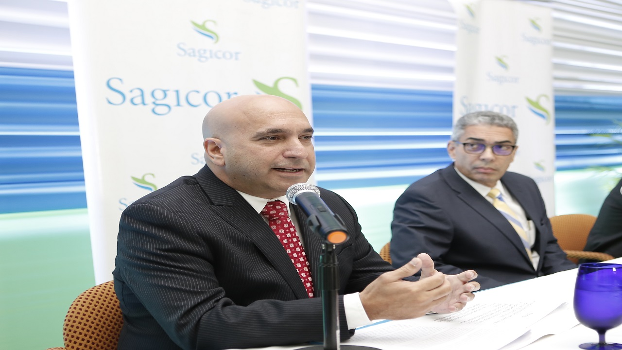 In this file photo, Sagicor Group Jamaica president and CEO Christopher Zacca addresses an audience while Sagicor Group Jamaica chairman Richard Byles looks on.