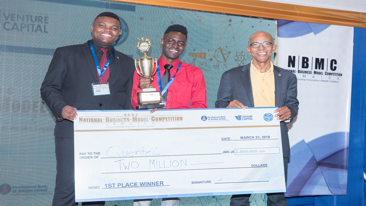 The 2018 Winners of the National Business Model Competition and students of the University of the West Indies, Kevonne Martin, VP of Marketing and Operations, Queritel and Shani Bennett, CEO and Founder, Queritel with Development Bank of Jamaica's Managing Director Milverton Reynolds.